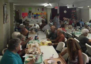 Community members congregate at Isleta United Methodist Church to enjoy the church's annual ice cream social on Saturday, July 9. Andrew Everhart | Beacon