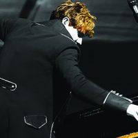 Upside down piano player Jason Farnham educates and performs