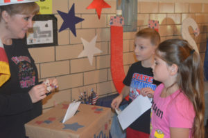 Tiffany Haines (far left) is pictured helping second graders at Keene Elementary School cast their ballot in the school's mock election that was held Nov. 8. Josie Sellers | Beacon