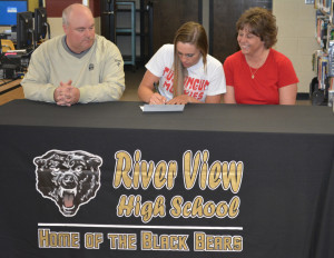 Signing: Heather Maxwell, center, signed her letter of intent to play women's soccer at Muskingum University on April 28 in the library at River View High School. Pictured with Heather are her dad, Ed, at left, and mom, Amy, at right. Beacon photo by Josie Sellers