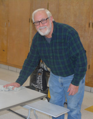 George Myers is pictured wiping down the tables at Warsaw Elementary School. He has been the janitor there for 37 years and will official retire as of Jan. 3. Josie Sellers | Beacon