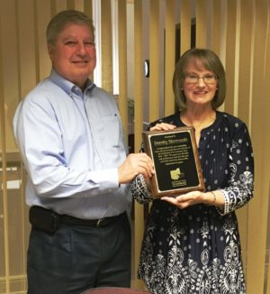 Dorothy Skowrunski is pictured at right with Robert Simpson, owner of MFM and the Coshocton Port Authority Board Chairman. Simpson presented Skowrunski with a plaque honoring her for her years of service as the port authority's executive director. Contributed | Beacon