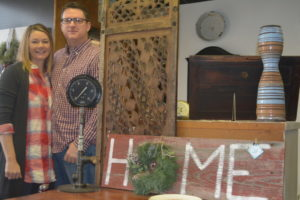Jennifer and Greg Coffman pose for a picture near some of the items available for purchase at Jennifer's Rust Decor. The home decor store will be open to the public the first weekend of the month and feature new items every time. Josie Sellers | Beacon