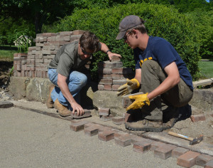 David Baker and Noah Adelsberger worked together on a patio project behind the Roscoe Village Visitor's Center. Josie Sellers | Beacon