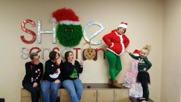 Shoe Sensation did a Christmas wreath display behind their counter at the Coshocton store. Pictured l-r: Terri Sheck, Denise Hardy, Lori Wright, Rachelle Bible, and Cortana Bible, Rachelle's niece.