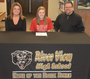 River View High School's Zoe Smalley, center, signed to play soccer at Wheeling Jesuit University. She is pictured with her mother Lynnette Dobson and father Chris Smalley.  Josie Sellers | Beacon