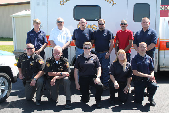 Coshocton County EMS was recently awarded its sixth Star of Life Award in 17 years. They received a plaque for their accomplishment and the other agencies involved with the April 2016 accident that earned them the award were recognized with label pins. Pictured in row one from left are: Coshocton County Sheriff's Office - Sgt. John Glasure and Deputy Mark Sharrock; Coshocton County EMS – Jennifer Singleton, EMT – Paramedic and Donna Carpenter – EMT Advanced; Coshocton Fire Department – Russell Dreher; back row: Coshocton Fire Department - Capt. Dexter Conkle and Chief Mike Layton; Jackson Township Fire Department – Lt. Keith Krebs, Keith Krebs II, Assistant Chief Dave Foster; and Coshocton Fire Department – Fred Shaw. Not pictured, but also responding to the accident were: Coshocton County EMS – Jon Tanner, EMT – Paramedic, Blaine Schooley, EMT – Paramedic, Emily Stevens – EMT – basic; Jackson Township Fire Department – Capt. Greg Rice, Lt. Lane Teater, Shane Harrah, Rick Williamson, John Rice, Cord Stottemire, Kenny Zigan, Mike Freetage; MedFlight – Mike McCollum, pilot, Streeter Clow, flight nurse, Jeff Parks, flight medic; and Coshocton County Sheriff's Office – Deputy Ernie Snyder. Contributed | Beacon