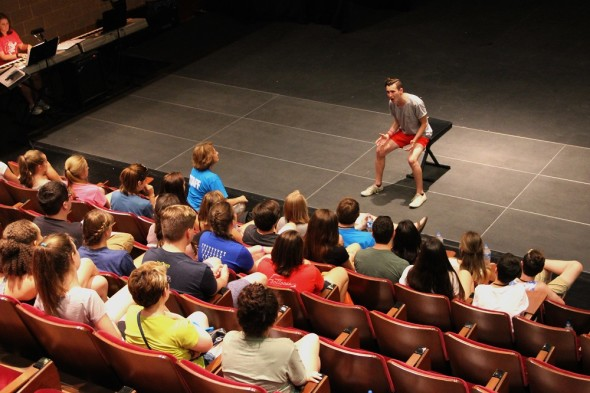 Student Howard Leuthold of Ontario, Ohio (on-stage and singing) is coached by Summer High School Music Theatre CAMP Director Carol Wilcox Jones.
