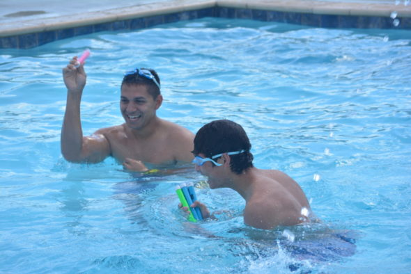 These brothers from Texas share a laugh while enjoying the new pool at the Coshocton KOA Campground. Josie Sellers | Beacon