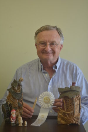 Tim Jackson has been creating woodcarvings for 13 years and recently earned a third place ribbon at the Dayton Carvers Guild for a half inch Santa Claus that he created. Josie Sellers | Beacon