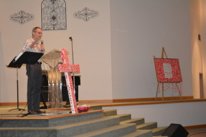 SPEAKER: Pastor Chris Cutshall of Fresno Bible Church was invited to speak at the Coshocton Christian School's Sanctity of Life program on Thursday, Jan. 22. In the background to the right, a bulletin board stands decorated with hearts that represent a baby who was aborted in the United States last year. BEACON PHOTO BY BETH SCOTT