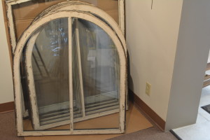 These are the windows that will be auctioned off during the Court House Open House on Saturday, Aug. 1. The windows were found during the court house renovations in much need of repair. They have been refurbished and will feature a scene of the Coshocton County Court House painted by eight local artists.