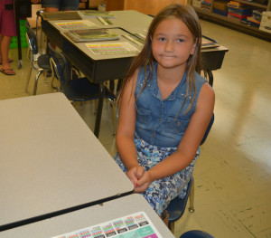 NEW SCHOOL YEAR: Warsaw Elementary had an open house for students and parents Friday, Aug. 21 so that students could meet their new teachers and view their classrooms. Pictured here is second grade student, Kaylynn Wylie at her desk. BEACON PHOTO BY BETH SCOTT