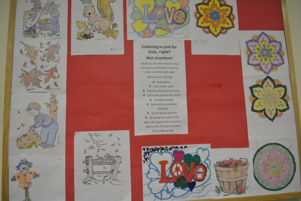 The Adult Bereavement Support Group participated in a coloring activity as a coping mechanism and hung some of their artwork up on the bulletin board in their meeting room.