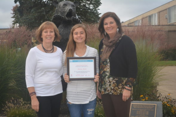 Madison Beach, center, was one of two national recipients of the Leaders Save Lives Scholarships from the American Red Cross. Also pictured are Shelley McPeek, school nurse (left), and Tricia Ford, American Red Cross representative (right).