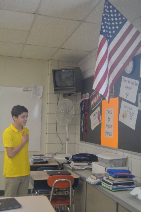 Jeremiah Mayle is pictured saying the Pledge of Allegiance at River View Junior High School. Mayle had a petition signed by students and staff to reinstate the Pledge.