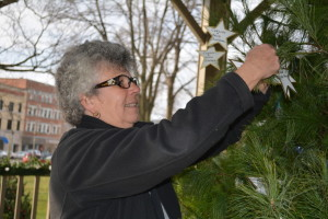 VOLUNTEER: Barb Wilson hangs stars with names of loved ones who have passed away on the Community Remembrance Tree. Residents who would like to have a name put on the tree should call Health Services and Hospice of Coshocton at 622-7311. BEACON PHOTO BY BETH SCOTT