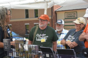 Bing Futch, far left, greets visitors to the 2016 Coshocton Dulcimer Days Festival. This year's festival will be June 16 – 18 in Historic Roscoe Village and has something to offer both dulcimer performers and those who love their unique sound.