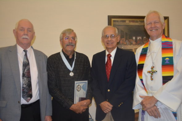 Stewart Henderson (left) and Denny Lowe (second from left) were awarded the God and Service Award on Sunday, April 23 at the Presbyterian Church in Coshocton. Also pictured are Jim Gill and Pastor Jon Carlisle.