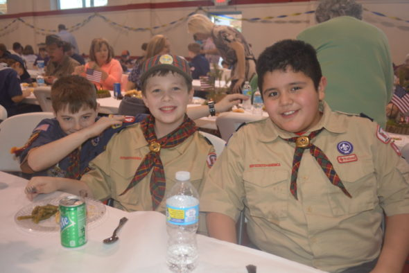 Aiden Stevens-Woolery, Anthony Cichon, and Julian Rivera enjoyed dinner at the annual Blue and Gold dinner hosted by Cub Scout Pack 403 at Sacred Heart on Saturday, Feb. 18.