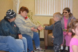 Children from Head Start handed out hand-made Christmas cards and gingerbread ornaments at the Senior Center on Tuesday, Dec. 20. In return, the seniors gave them items to use in their classroom. Beth Scott | Beacon