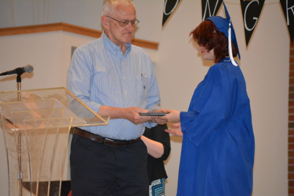 Ruth-Anne Coates, 2016 graduate of the Coshocton Christian School, is pictured with Principal Stan Zurowski as he hands Ruth-Anne her high school diploma.