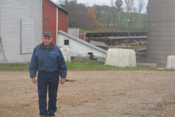 Martin Daugherty stands in front of his 1400-acre family farm that has been in his family since 1875. Martin took over the farm in 1949 after his father died unexpectedly when Martin was 18 years old.