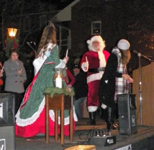 Megan Stonebraker, 2016 Coshocton Canal Days Queen, lights the first candle at the Roscoe Village Candlelighting on Dec. 3. Jen Jones | Beacon