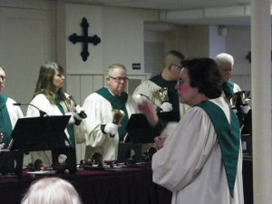 Leslie Dawson directs the hand bell choir from Grace UMC at the Ring the Bells for Habitat Concert Sunday, April 9 at the Presbyterian Church. Jen Jones | Beacon