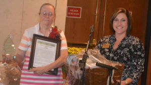 Linda Taylor (left) was selected as the Caregiver of the Year at the 11th annual Coshocton County Caregiver Appreciation Luncheon that was held Oct. 7 at Coshocton Village Inn and Suites. She received a framed copy of her nominations, a plaque and a gift basket from Oak Pointe Nursing & Rehabilitation Center in Baltic. Josie Sellers | Beacon