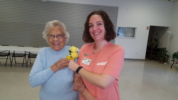 50-year Coshocton BPW member Eva June Kiser is presented a corsage by President Carla Fowler.