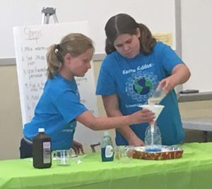 "Piper Andrews (left) and Kiera McPeck (right) present their experiment entitled, ""Fizzy Foam Fun,"" during a 4-H public speaking competition at Frontier Power on Tuesday, July 19."