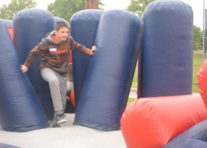 Coen Bible from River View Junior High is pictured working his way through the National Guard obstacle course set up at Youth Health Day on May 11 at Kids America. Josie Sellers | Beacon