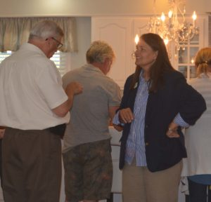 America in Bloom Judge Linda Cromer, right, is pictured chatting with Mayor Steve Mercer. A community reception for the judges was held June 27 at the home of Daphne and Tim France. France is president of Coshocton is Blooming, which organized the judges' visit to Coshocton. Josie Sellers   Beacon