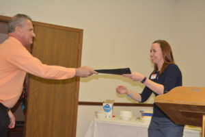 Coshocton County Commissioner Gary Fischer presented Emily Adams from the OSU Extension Coshocton County Office with a proclamation for the National Ag Day celebration in Coshocton County. Josie Sellers | Beacon