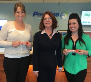 Equal Pay: Coshocton BPW Treasurer Aimee Neighbor from People's Bank, President Carey McMasters from Jacobs Vanaman Insurance and Membership Chair Samantha Vincent from The Coshocton Tribune hold Pay Day candy bars that will be given out on Tuesday, April 12 on Equal Pay Day to bring attention to the wage gap. Photo contributed to The Beacon