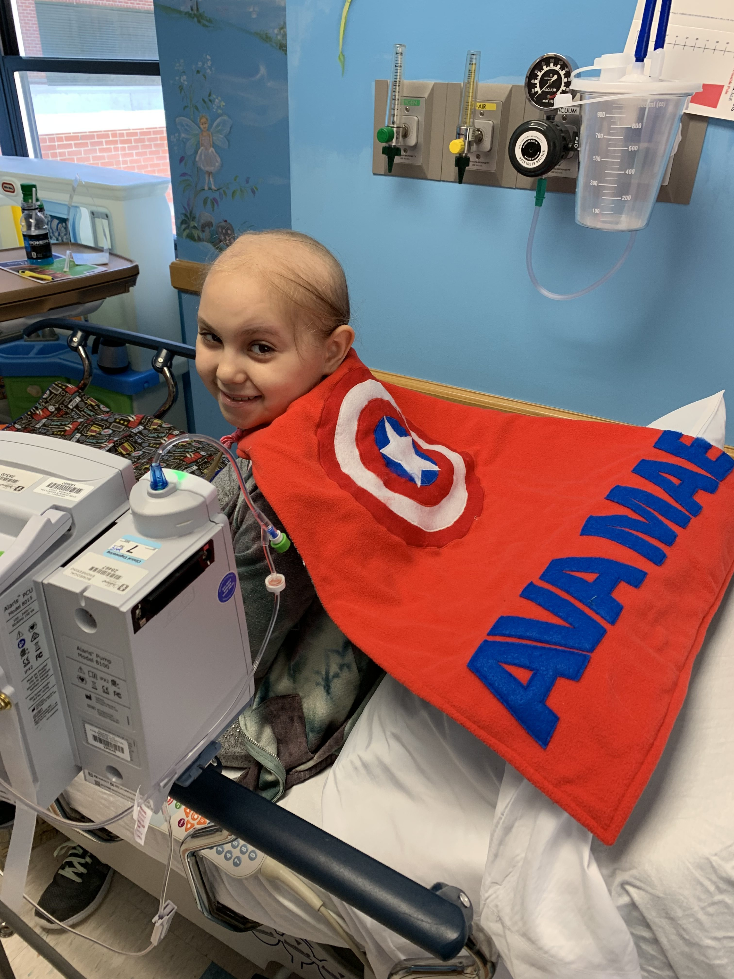 Ava Akron chemo (cape made by hospital volunteer)