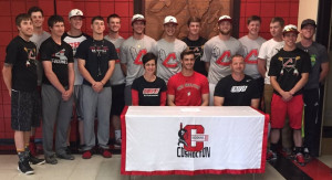 Coshocton senior Talon Babcock sits with his parents Angie and Tom Babcock and his teammates while signing his national letter of intent to play baseball at Ohio Wesleyan University. Andrew Everhart | Beacon