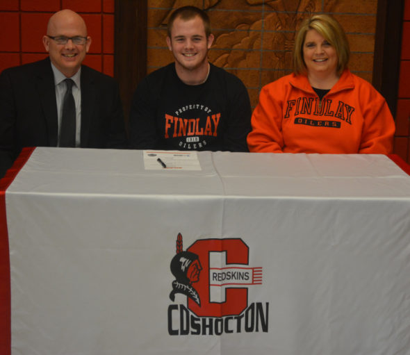 Ben Batchelor, center, signed his letter of intent to play soccer at the University of Findlay on Feb. 8 at Coshocton High School. He is pictured with his father and mother, Bob and Shelley Batchelor. Josie Sellers | Beacon