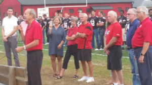 "Ceremony: Richard ""Dick"" Wharton, the son of legendary Coshocton High School football coach Schuyler ""Sky"" Wharton addressed the crowd at the school meet the team on Aug. 17 at Stewart Field.  After the event a sign was unveiled dedicating a portion of the street in front of the field to Sky. Beacon photo by Josie Sellers"