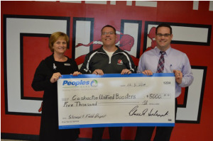 Donation: Phil Hunt and Debbie Shryock of Peoples Bank presented a $5,000 check to Tim Fortney of the Coshocton Unified Boosters. Funds will be used for the Stewart Field Community Renovation Project. Photo contributed to The Beacon