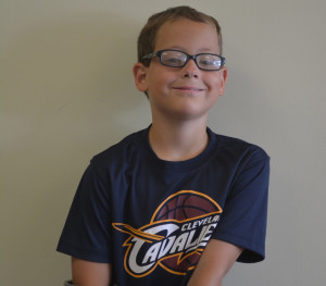 Nine year old Cody Croy's favorite sport is basketball and he's been a lifelong fan of the Cleveland Cavaliers. At the team's celebration parade, he was given the opportunity to briefly be on J.R. Smith's float.  Josie Sellers | Beacon