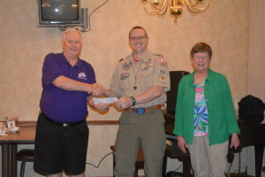 Chip Udischas, center, received $500 from Coshocton Elks Lodge 376 to use for the local Sea Scouts organization. He is pictured here with Mike Wilson, exalted ruler, left, and Marlene Griffith, local chairperson of the Elks National Foundation, right.