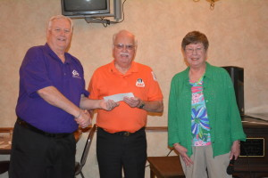 Rocky Roahrig, center, received $500 from Coshocton Elks Lodge 376 to use for the Coshocton County REACT program. He is pictured here with Mike Wilson, exalted ruler, left, and Marlene Griffith, local chairperson of the Elks National Foundation, right.