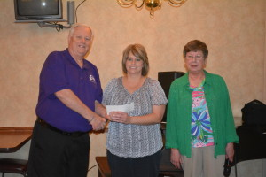 Tammy Lanham, center, received $500 from Coshocton Elks Lodge 376 to use for the local Girl Scouts organization. She is pictured here with Mike Wilson, exalted ruler, left, and Marlene Griffith, local chairperson of the Elks National Foundation, right.