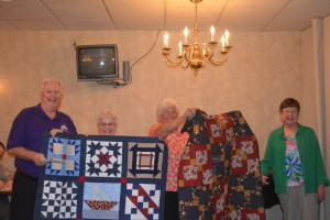 Karen Caley and Cathy Wegener received $500 from Coshocton Elks Lodge 376 to use for the Canal Quilters. Pictured left to right are Mike Wilson, exalted ruler, Caley, Wegener, and Marlene Griffith, local chairperson of the Elks National Foundation, right.