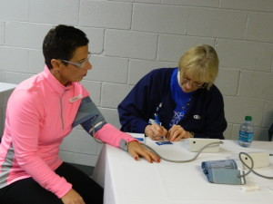Health check: Diane Erwin is pictured getting her blood pressure checked at the 2014 Health, Safety, and Wellness Expo. This year's expo will be held from 9 a.m. to 1 p.m. Saturday, Jan. 17, at Kids America. Beacon file photo