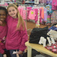 Volunteers and shoppers enjoy Christmas Castle project