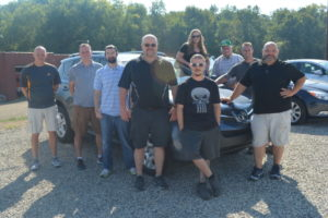 Staff members at Joe Brush Auto Sales gathered together for a photo by one of the vehicles available at the dealership located on County Road 621.