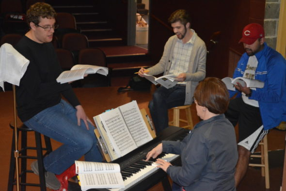 "Heath Chaney, Donovan Rice and Luke Widder practice music from ""Forever Plaid"" with Jane Crow, who plays the piano in the production. ""Forever Plaid"" by Stuart Ross will be performed at 8 p.m. May 5-6, 12, 20 -21 at the Triple Locks Theater and at 2 p.m. May 14. Josie Sellers 